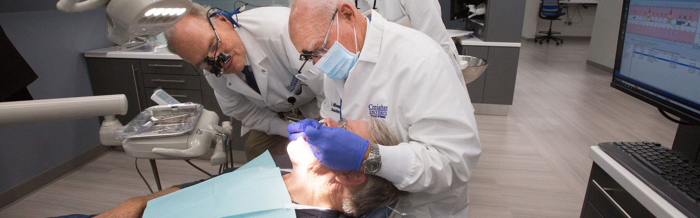 Dentists treating dental patient