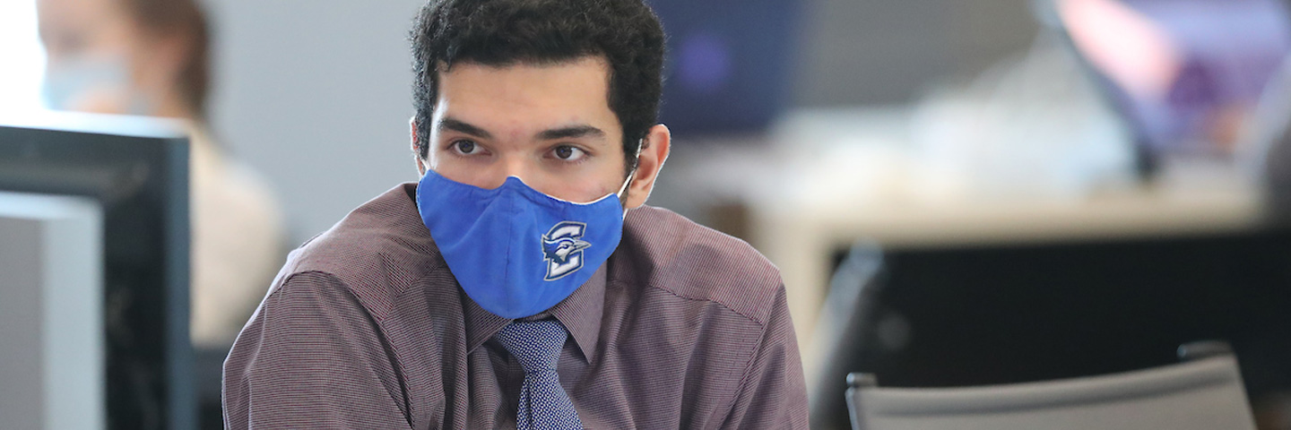 Creighton University student wearing a Creighton mask during COVID-19