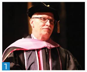 Dean Latta waiting to congratulate a student at the School of Dentistry Hooding Ceremony in May 2018.