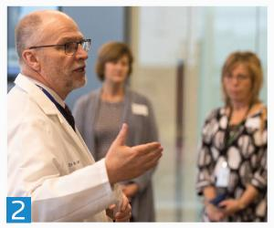 2. Dean Latta leads a group on a tour as part of a community partners dental gathering at the new dental building.
