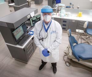Joseph-Franco Jr., BA'80, DDS'84, in the Creighton Dental Clinic